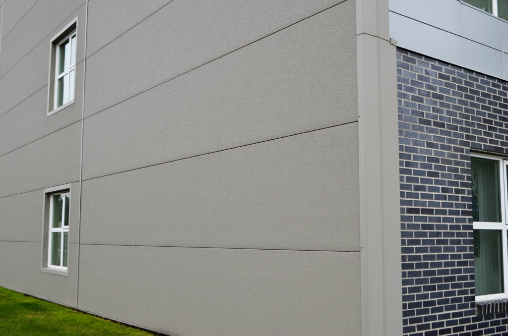 Insulated steel panels with a stucco finish capping off the sides of the Westwood apartments for additional insulation