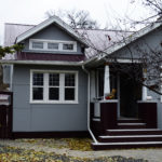 Burgundy metal roofing panels and insulated grey metal wall panels